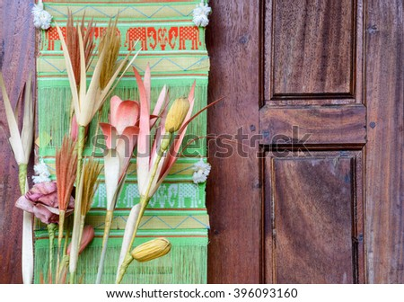 Artificial Flower Vase and Textiles Thailand with wooden - stock photo