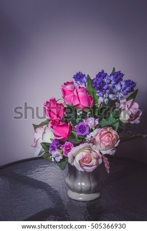 Artificial flowers in a white vase background