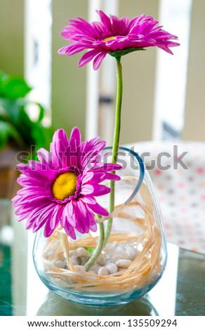 artificial flowers in jug on the table - stock photo