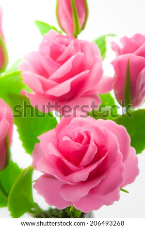 Artificial Flowers made �¢??�¢??of japanese clay. Isolated on white background - stock photo