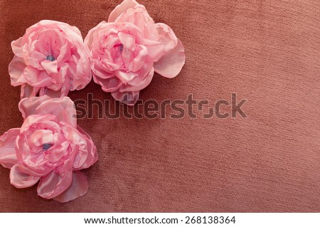 artificial flowers pink handmade velor tissue background - stock photo