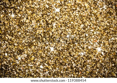 Artificial gold ornaments background with sparkling - stock photo