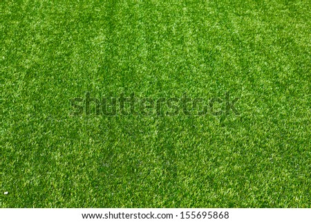 Artificial grass selective focus background - stock photo