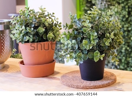 Artificial Green Plants or Artificial Plants in Flower Pots for Home and Office Decoration without The Care. - stock photo