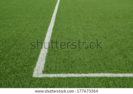 Artificial green turf texture background with white line mark