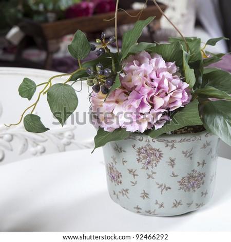 artificial hydrangea in vase - stock photo