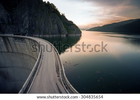 Artificial Lake behind the Bicaz Dam at sunset, Romania - stock photo