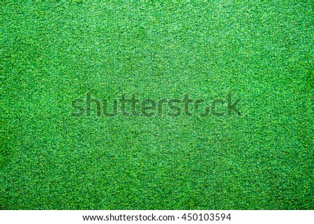 Artificial lawn grass green bright texture background
