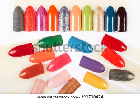 Artificial nails different colored with nail polish