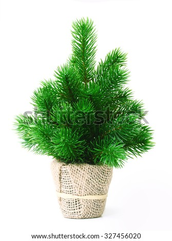 Artificial pine tree in pot isolated on white - stock photo