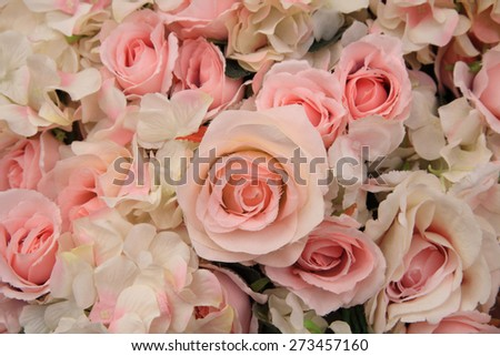 Artificial pink rose flowers for wedding decoration, Textured background - stock photo