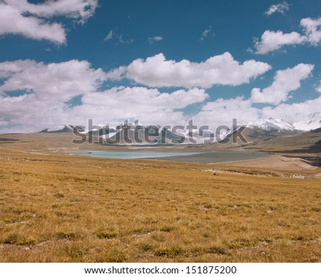 Artificial reservoir in the mountains of Central Asia at the height of 4,000 meters