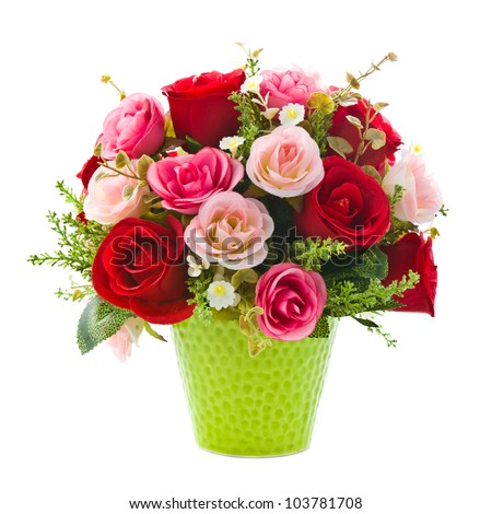 Artificial rose flowers in green vase on white background - stock photo