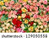 Artificial rose flowers mixed bouquet - stock photo