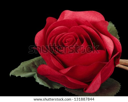 Artificial rose isolated on black - stock photo