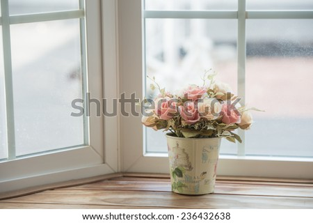 Artificial roses in the basket in vintage theme - stock photo