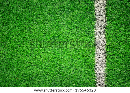 Artificial soccer grass field detail with white goal line. Vintage filter effect used. - stock photo