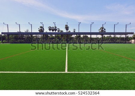 Artificial turf football field stadium football field with white lines on grass.