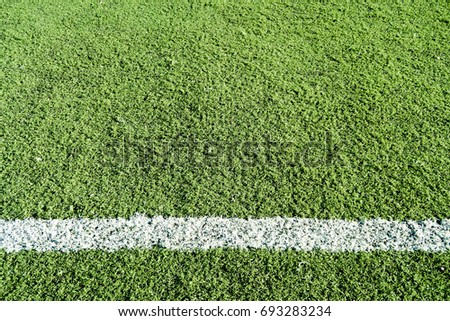 Artificial turf football with white stripe