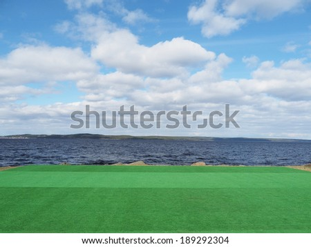 artificial turf on the lake - stock photo
