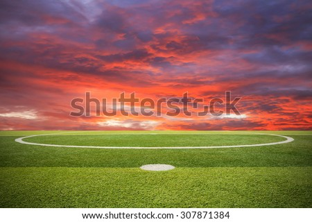 Artificial turf soccer field and sunset - stock photo