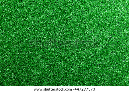 Artificial turf. Studio shot. Green background. Copy space.
