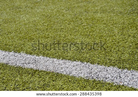Artificial turf with a line of chalk