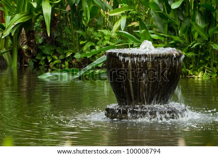 Artificial waterfall in the resort. - stock photo