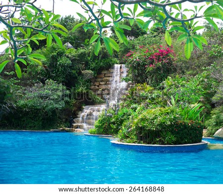 artificial waterfall. photo pool with an artificial waterfall in one of the Resort in Thailand - stock photo