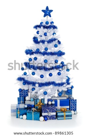Artificial white christmas tree on white, decorated with blue ornaments and garland, lots of presents under the tree - stock photo