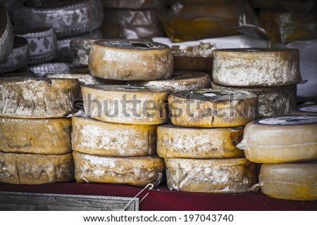 artisan food stalls, cheese, meat, stuffed into a medieval fair - stock photo