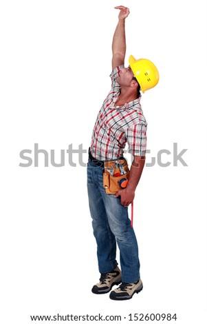 Artisan hand measuring object - stock photo