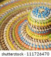 Artisan hat for protection from the sun in African style closeup image - stock photo