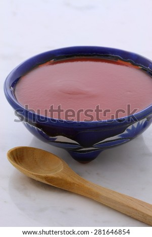 Artisan mexican hot salsa in vintage talavera bowl, with a delicious fresh hot flavor,  on vintage carrara marble table. - stock photo