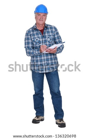 Artisan writing in notebook - stock photo