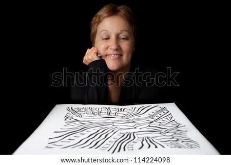 Artist admiring her work - stock photo