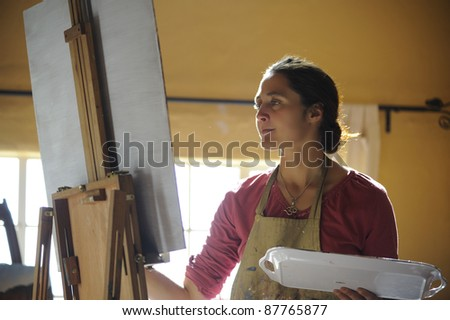 Artist at work in studio. - stock photo