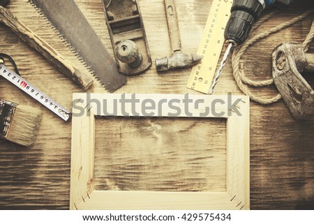 Artist canvas, canvas stretcher, staple gun and paintbrushes on table - stock photo