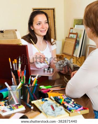 Artist draws a portrait of a mature woman - stock photo
