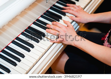 Artist hands of a piano player  with notes