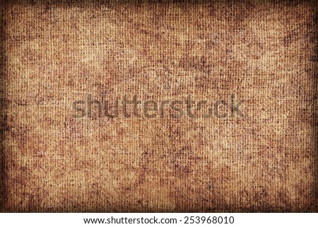 Artist Jute raw Canvas, unrefined, non caulked, unsealed, single Acrylic primed, extra coarse, bleached, mottled, vignette grunge texture sample. - stock photo