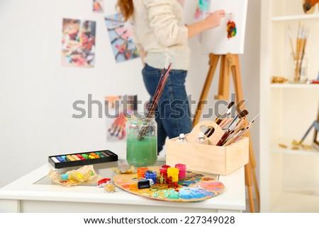 Artist painter on canvas in art studio - stock photo