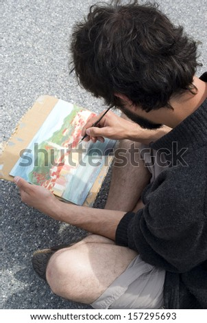 Artist painting a picture, outdoors
