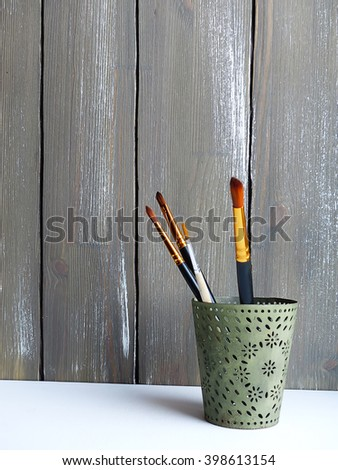 artist's brushes, selective focus and toned image - stock photo