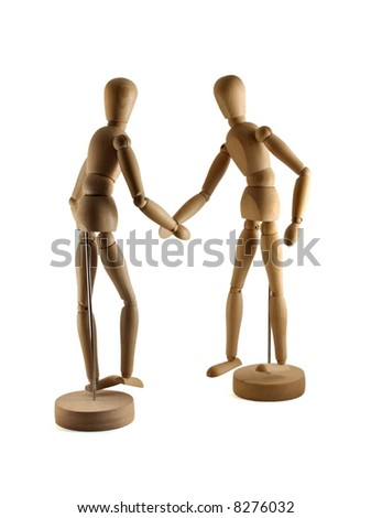 artist's figures shaking hands - stock photo