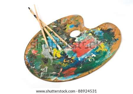 artist's palette with colorful paint and brushes.