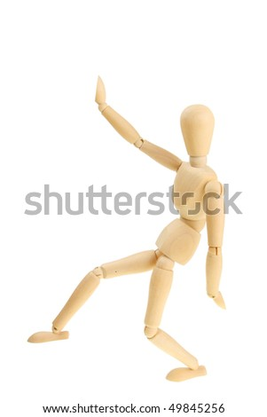 Artist's wooden mannequin in a martial arts pose