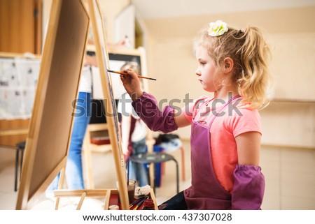 Artist school girl painting watercolor brush - stock photo