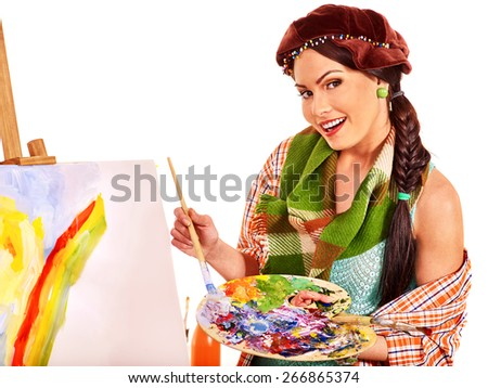 Artist woman in brown hat at work. Isolated. - stock photo