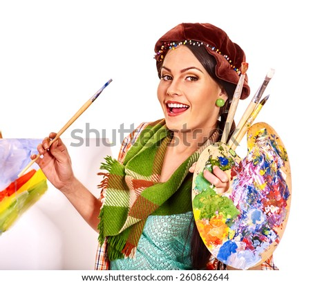 Artist woman weering hat at work. Isolated. - stock photo